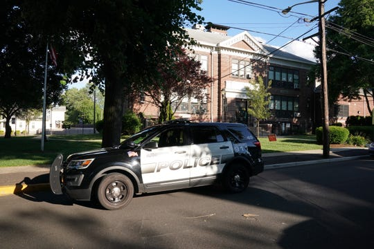 Police at the Washington School in Rutherford June 14, 2019 after a principal at the school was stabbed by a student during graduation rehearsals.