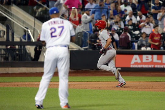 Jun 14, 2019; New York City, NY, USA; St. Louis Cardinals shortstop Paul DeJong (12) rounds the bases after hitting a solo home run against New York Mets relief pitcher Jeurys Familia (27) during the eighth inning at Citi Field.