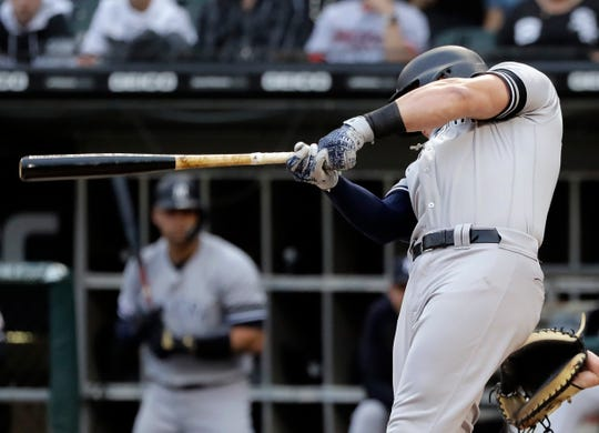 New York Yankees' Luke Voit hits a solo home run against the Chicago White Sox during the first inning of a game in Chicago, Friday, June 14, 2019.