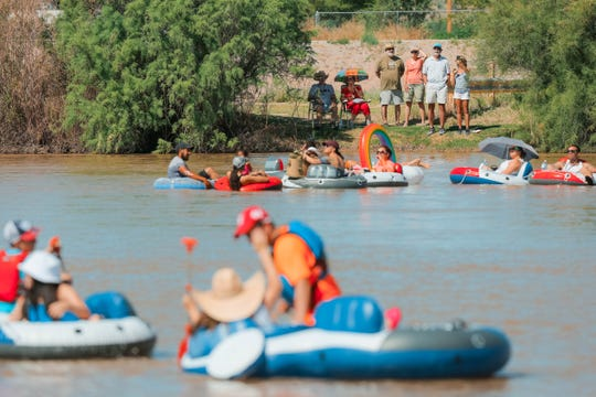 Spectators watch as participants float down the Rio Grande at the Raft The Rio annual event at La Llorona Park in Las Cruces on Saturday, June 15, 2019.