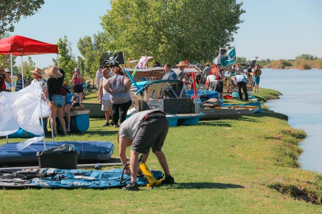 Participants get their boats ready to float down the Rio Grande at the Raft The Rio annual event at La Llorona Park in Las Cruces on Saturday, June 15, 2019.