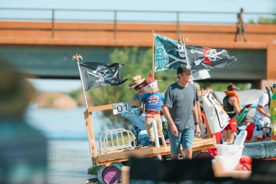 Participants float down the Rio Grande at the Raft The Rio annual event at La Llorona Park in Las Cruces on Saturday, June 15, 2019.