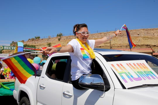 Amanda Flores of Farmington celebrates Pride Month during Saturday's fourth annual parade along Main Street in downtown Farmington.