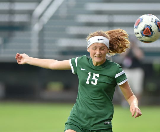 Novi Wildcat Avery Fenchel used her head, and feet, to help Novi to its second straight soccer title on June 15. Fenchel scored the Wildcats' first two goals of the day.