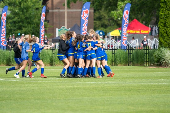 Marian celebrates winning the D2 soccer state title, June 14, 2019.
