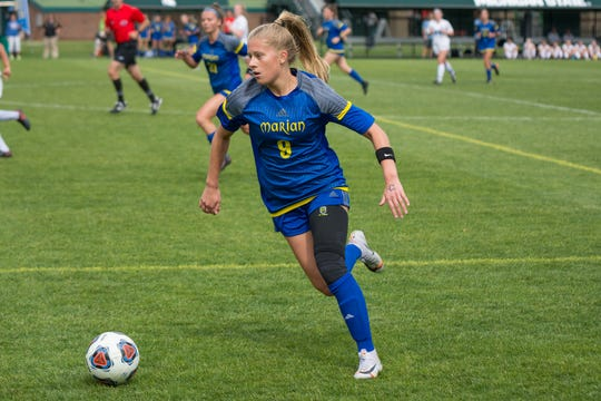 Marian senior Jansen Eichenlaub dribbles down the field in the Division 2 state final against Grand Rapids Forest Hills Northern on June 14, 2019. Marian won 2-1.