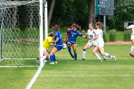 Marian sophomore Maria Askounis scores the game-winning goal in the Division 2 state final against Grand Rapids Forest Hills Northern on June 14, 2019. Marian won, 2-1.