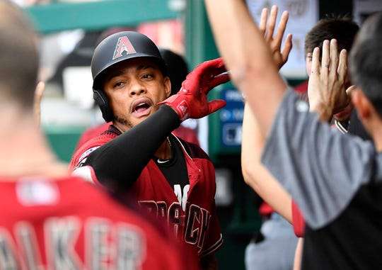 Jun 15, 2019; Washington, DC, USA; Arizona Diamondbacks center fielder Ketel Marte (4) is congratulated by teammates after hitting a solo home run against the Washington Nationals during the fourth inning at Nationals Park. Mandatory Credit: Brad Mills-USA TODAY Sports