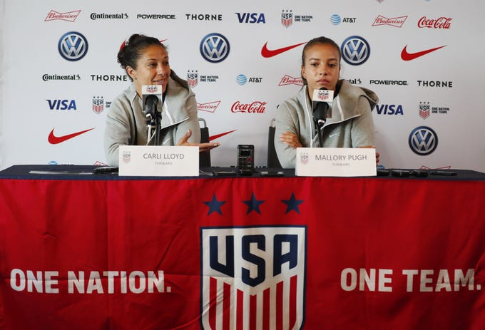 Jun 14, 2019; Paris, FRA; The United States forwards Carli Lloyd (left) and Mallory Pugh answer questions during a Team USA press conference in the FIFA Women's World Cup France 2019 at Hotel Melia La Defense.