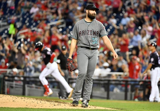Jun 14, 2019; Washington, DC, USA; Arizona Diamondbacks starting pitcher Robbie Ray (38) reacts after giving up a solo home run to Washington Nationals third baseman Anthony Rendon (left) during the sixth inning at Nationals Park.