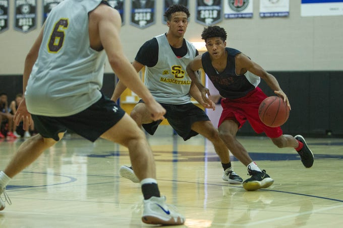 Perry senior Jalen Moreland drives against Salpoint defense in the Prime Time boys basketball tournament championship held at Mesquite High School on June 15, 2019. Salpoint went on to defeat Perry.