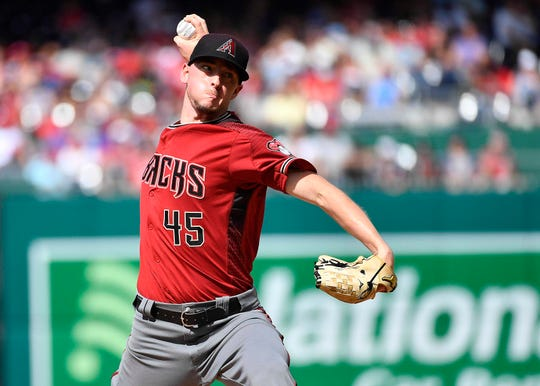 Jun 15, 2019; Washington, DC, USA; Arizona Diamondbacks relief pitcher Taylor Clarke (45) throws to the Washington Nationals during the first inning at Nationals Park. Mandatory Credit: Brad Mills-USA TODAY Sports