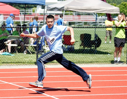 Huey Peralta wins his heat of the 200 meter dash in the Special Olympics Summer Games held at Vassar College in the Town of Poughkeepsie on June 15, 2019.