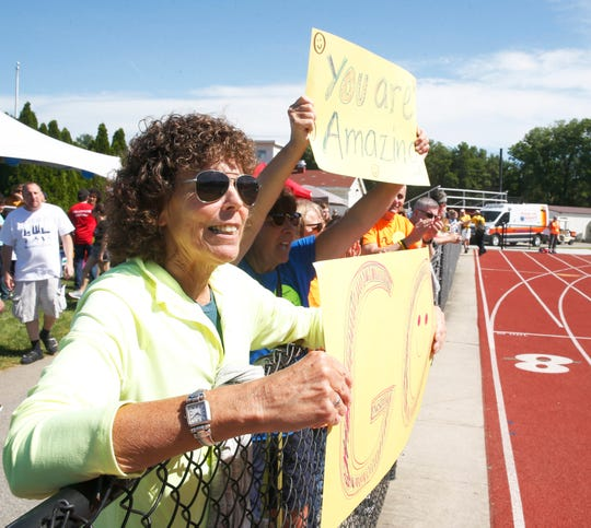 From left, Pat Henneberger of Gardiner and Laura Corbett of New Paltz cheer on athletes during track events at the Special Olympics Summer Games held at Vassar College in the Town of Poughkeepsie on June 15, 2019.