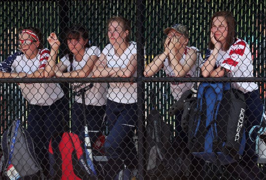 Pine Plains players watch from the dugout as their season comes to an end against Warsaw in the softball state semifinal at Moreau Recreational Park in Glens Falls, New York June 15, 2019.