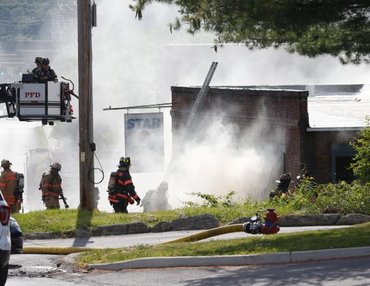 Fire departments respond to an active fire at 33 Fulton Street in the Town of Poughkeepsie on June 15, 2019.
