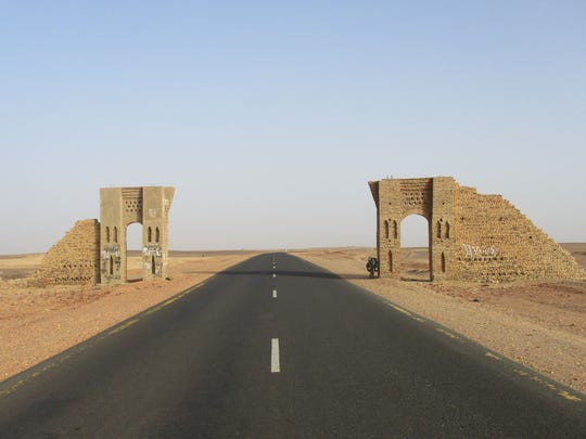 Cornel Mancas said he had to mentally prepare for stretches of nothingness in the Sudan. Here he took a photograph of some of the ruins along the deserted road along his trip across Africa.