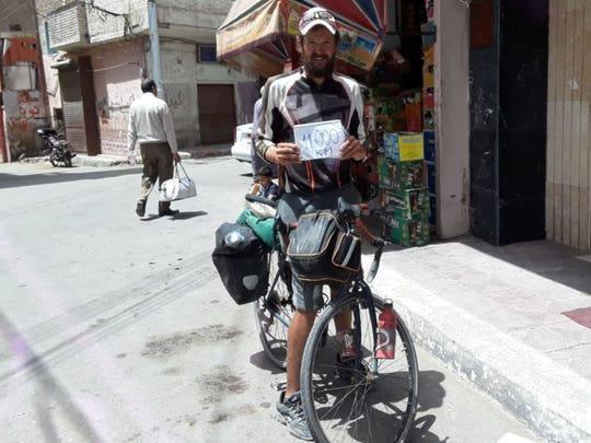 Cornel Mancas poses along a street in Egypt near the end of his journey across Africa. He estimated he had pedaled 11,000 kilometers or about 6,830 miles during this point in his journey. He would pedal a total of 11,779 kilometers before reaching the Mediterranean Sea.