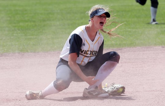 Victor's Emily Power celebrates after tagging out Cicero-North Syracuse's Jaqueline Cupoli on a steal attempt at second base in the Class AA softball state semifinal at Moreau Recreational Park in Glens Falls, New York on June 15,  2019.