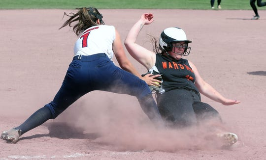 Warsaw's Riley Marshall slides safely as Pine Plains Lourdes Belanger applies the late tag in the Class C softball state semifinal at Moreau Recreational Park in Glens Falls, New York on June 15,  2019.