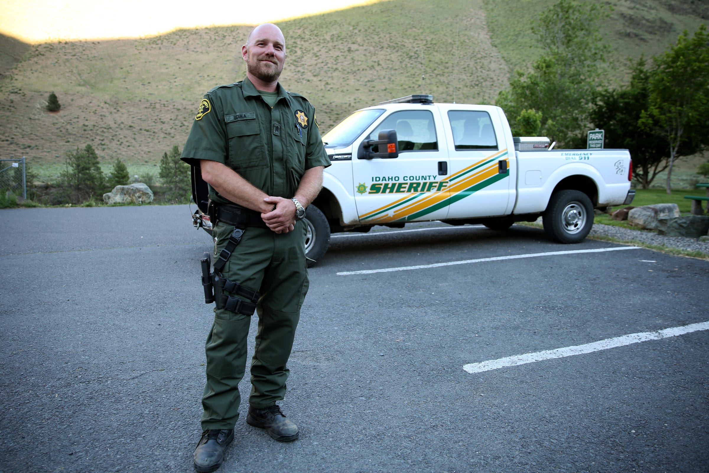 Sgt. Justin Scuka, with the Idaho County Sheriff's Office, speaks on wildfire evacuations plans in Riggins, Idaho on June 11, 2019.