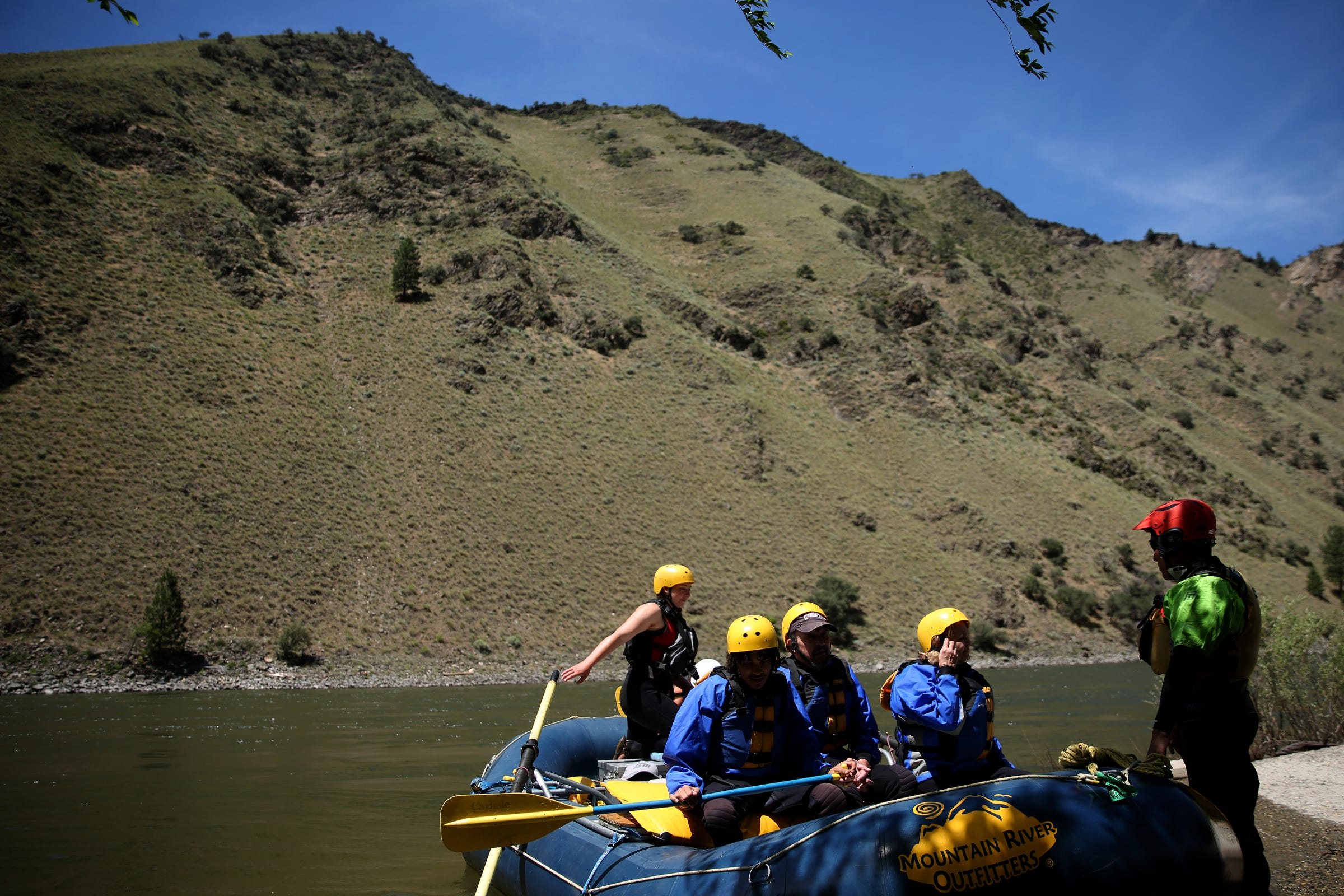 Mountain River Outfitters leads a rafting trip for tourists form Utah on the Salmon River at Riggins, Idaho on June 12, 2019.