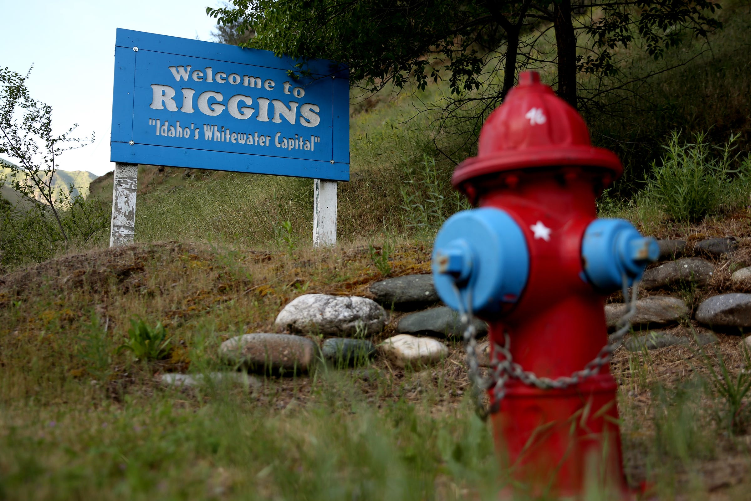 """A fire hydrant in front of the """"Welcome"""" sign on the north end of Riggins, Idaho on June 13, 2019."""