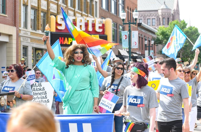 A drag queen dressed as the Statue of Liberty walks with ACLU representatives in the first-ever Pride parade Saturday, June 15, in downtown Sioux Falls.