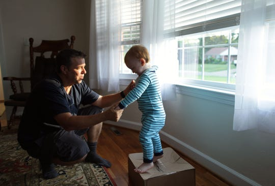 Pat Gallagher plays with his son Patrick, 22 months, at their home in Virginia Beach on June 11, 2019.