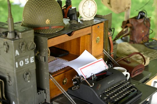 Numerous displays showcase items and life during the 1940s at a WWII reenactment Saturday, June 15 at Stearns History Museum.