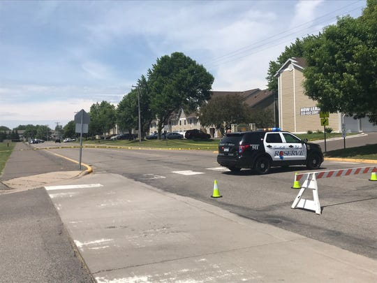 Law enforcement blocks part of Seventh Street North in Sartell while authorities investigate a shooting Saturday, June 15.