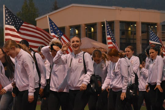 Athletes, locals and volunteers take part of, and eventually get rained on during, the opening ceremonies of the 2019 Larry H. Miller Utah Summer Games on Friday, June 14, 2019.