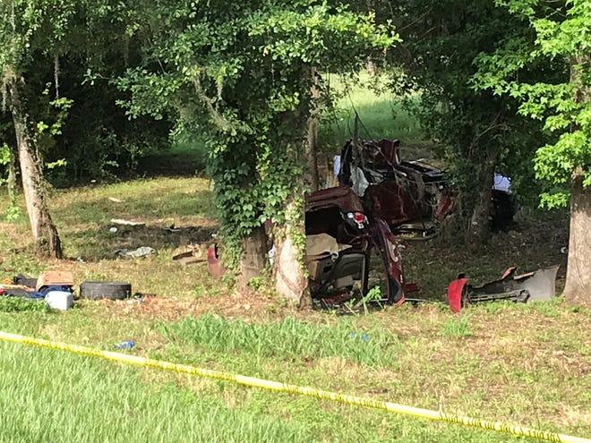 The vehicle that was split in half after colliding with a tree