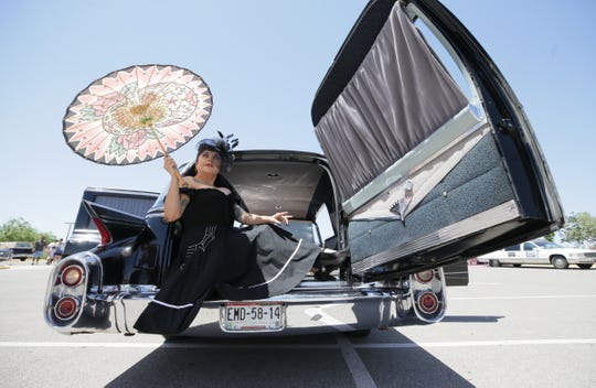 Deady Page feels right at home lounging in the business end of a 1960 Cadillac hearse Saturday at the first ever Hearse & Classic Car Show at Perches Funeral Home West.
