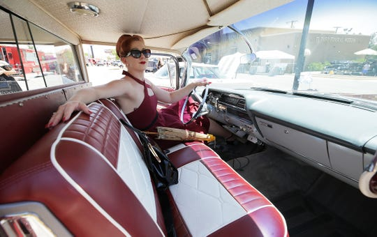 Ashley Triana's burgundy halter strap number seemed destined to be with this classic hearse.