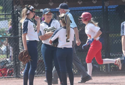 Walter Panas players meet on the pitchers mound as Williamsville East eighth-grader Ella Wesolowski rounds the bases after a 3-run homer, her second home run of the game, during the softball state semifinal at Moreau Recreational Park in Glens Falls, New York June 15,  2019. Williamsville East won the game 6-0.