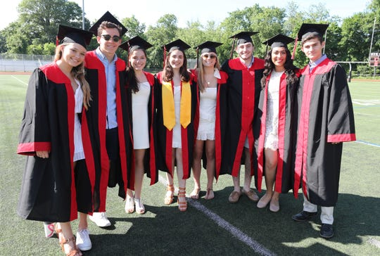 The Rhythm on Rye singing group pose for a photo, as Rye High School celebrates their 88th commencement on the campus in Rye, June 15, 2019.