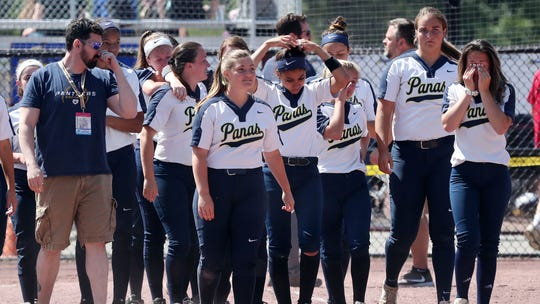 Walter Panas players walk off the field after they were defeated 6-0 by Williamsville East in the softball state semifinal at Moreau Recreational Park in Glens Falls, New York June 15,  2019.