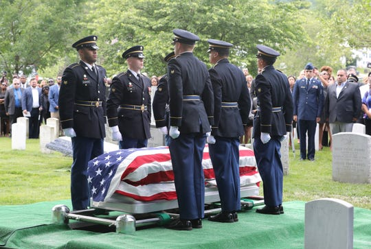 The military honor guard stand at attention over the casket of West Point Cadet Christopher J. Morgan, during his interment ceremony at West Point, June 15, 2019. Over 1500 family, friends and military personnel attended, as well as former President Bill Clinton who delivered remarks at the memorial service.