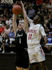 Hirschi's Qua Easter (11) and Graford's Preston Tabor go after the rebound in the Maskat Shrine Oil Bowl Basketball Classic Friday, June 14, 2019, at Rider High School.