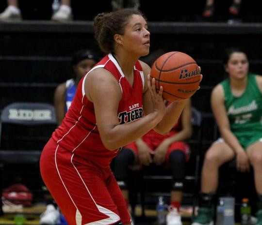 Electra's Alyssa Waggoner shoots in the Maskat Shrine Oil Bowl Basketball Classic Friday, June 14, 2019, at Rider High School.