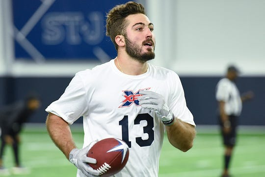 Vinny Papale takes part in the XFL Summer Showcase in Springfield, Virginia, for the Washington-based XFL team. Papale is the son of former Philadelphia Eagles player Vince Papale, whose story was the inspiration for the Disney movie 'Invincible.'