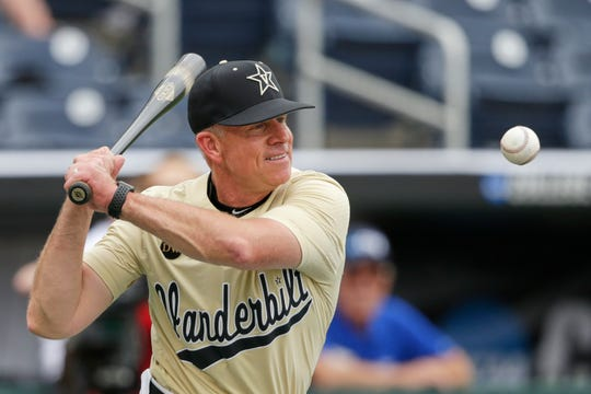 Vanderbilt coach Tim Corbin hits ground balls during practice Friday in Omaha.