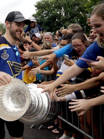 St. Louis Blues captain Alex Pietrangelo shows off  the Stanley Cup to fans.
