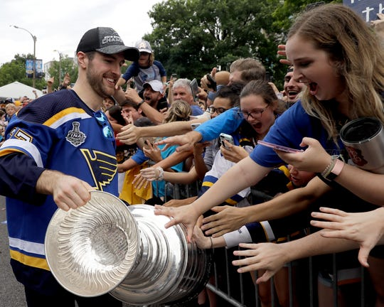 St. Louis Blues captain Alex Pietrangelo shows off  the Stanley Cup to fans.