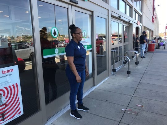At a Target in Boston, Nicole Florence, a  security officer, was tasked with telling shoppers Target was closed because of an outage.
