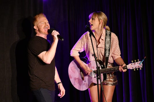 Jesse Tyler Ferguson (L) and Taylor Swift perform at AEG and Stonewall Inns pride celebration commemorating the 50th anniversary of the Stonewall Uprising on June 14. (Photo: Bryan Bedder, Getty Images for AEG)