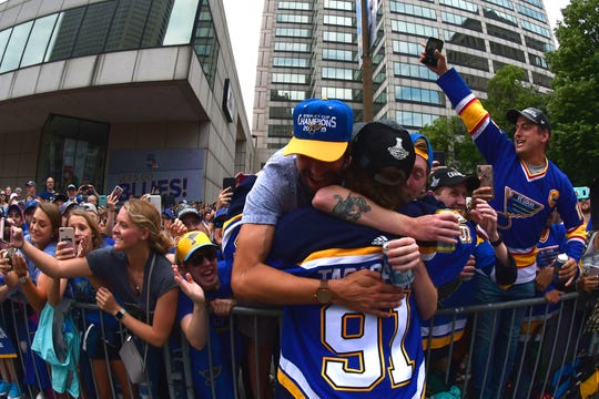 Vladimir Tarasenko is hugged by fans.