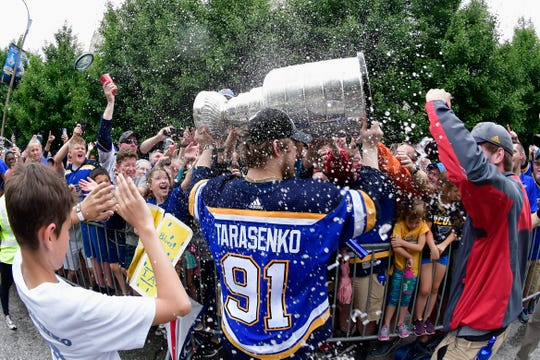 Right wing Vladimir Tarasenko is sprayed with beer.