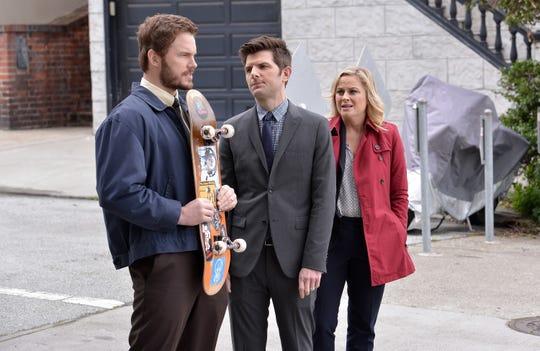 "Chris Pratt as Andy Dwyer, Adam Scott as Ben Wyatt, Amy Poehler as Leslie Knope in ""Parks and Recreation."""
